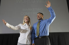 Man And Woman At Business Convention Stock Photos