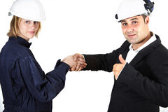 Man and woman business handshake. Builder blonde woman handshake with a male manager Royalty Free Stock Image