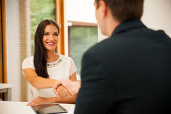 Man and woman on business meeting, sitting in the office, discus Royalty Free Stock Photo