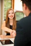 Man and woman on business meeting, sitting in the office, discus Stock Image