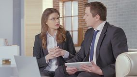Man and woman business partners come to agreement, shake hands stock footage