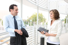 Man and Woman Business Team at Office Stock Images