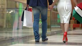 the man with the woman buy gifts for christmas big multi colored packages in - Man Gifts For Christmas