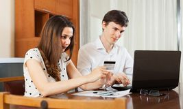 Man and woman buying online Stock Photo