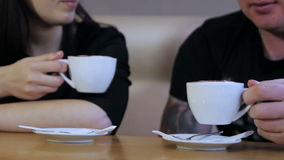 Man and woman in cafe stock video footage