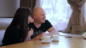 Man and woman in cafe stock footage
