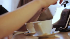 Man and woman in cafe. Young man and woman using tablet in cafe stock video footage