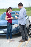Man and Woman After Car Accident Stock Image
