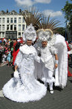 Man and woman in a carnaval parade. Man and woman in white costume (Zomercarnaval, Rotterdam, Netherlands, 25th of July 2009 stock images