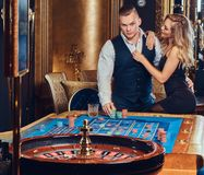 Man and woman in a casino. Stock Images