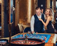 Man and woman in a casino. Royalty Free Stock Photo