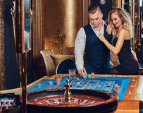 Man and woman in a casino. stock photos