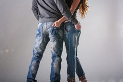 A man and a woman in casual jeans Stock Image