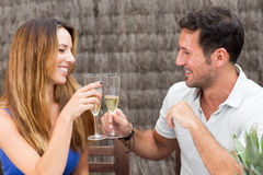 Man and woman celebrating with a toast. Man and women in love having fun and drinking champagne Royalty Free Stock Image