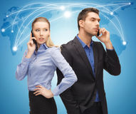 Man and woman with cell phones Royalty Free Stock Photos