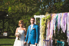 Man and Woman at Ceremony. Man and women at ceremony at decorated gate Royalty Free Stock Photography