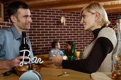 Man and woman chatting in bar Royalty Free Stock Images