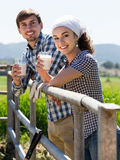 Man and woman chatting and enjoying milk outdoors Royalty Free Stock Image