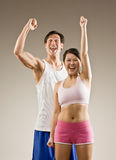 Man and woman cheering. And celebrating their success Stock Images