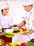 Man and woman in chef hat cooking. Royalty Free Stock Images