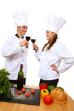 Man and Woman Chefs. Attractive man and woman chefs celebrating success with wine toast royalty free stock photo