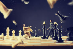 Man and woman on the chess board Royalty Free Stock Photo