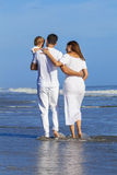 Man Woman Child Family Walking on Beach Royalty Free Stock Images