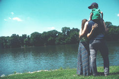 Man and Woman and Child Standing Beside Body of Water during Daytime Royalty Free Stock Photography
