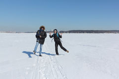 Man, woman and the child walking on the snow river in the winter Stock Photos