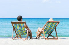 Man and woman chilling on a summer beach Royalty Free Stock Photography