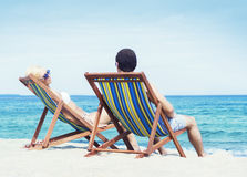 Man and woman chilling on a summer beach Stock Photography