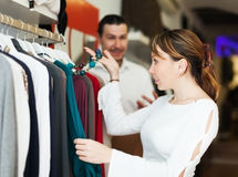 Man and woman choosing clothes at boutique Royalty Free Stock Image