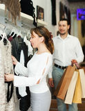 Man and woman choosing clothes at boutique Royalty Free Stock Images
