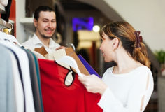Man and woman choosing clothes at store Stock Images
