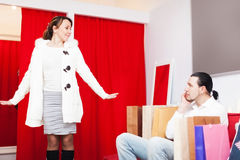 Man and woman choosing coat in fitting-room Stock Photo