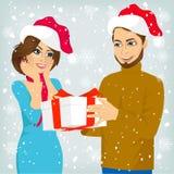 Man and woman with christmas present Stock Photo