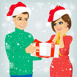 Man and woman with christmas present Royalty Free Stock Images