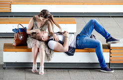 Man and woman on city bench. Stock Images