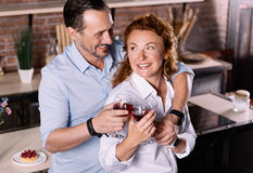 Man and woman clanging glasses together Stock Photography