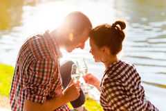 Man and woman clanging wine glasses with champagne Royalty Free Stock Image