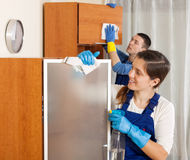 Man and woman cleaning in room Royalty Free Stock Photo