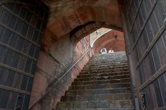 Man and woman climbing stairs of Humayun`s Tomb, in Delhi, India. stock photo