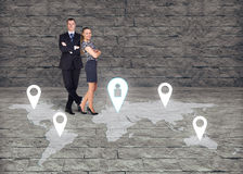 Man and woman close by each over on earth map stock image