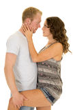 Man woman close hold her leg hands on his face Stock Images