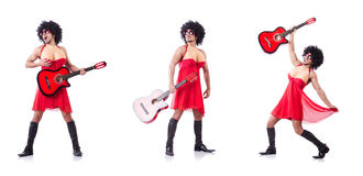 The man in woman clothing with guitar Stock Photos
