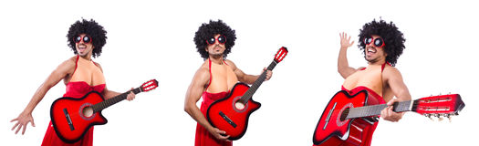 The man in woman clothing with guitar Stock Images