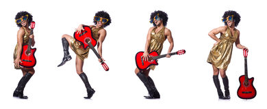 The man in woman clothing with guitar Royalty Free Stock Photos
