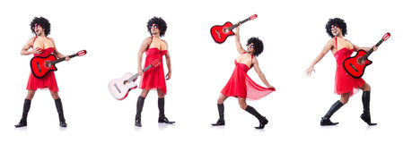 The man in woman clothing with guitar Royalty Free Stock Image