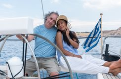 Man and woman in cockpit of sailboat royalty free stock images