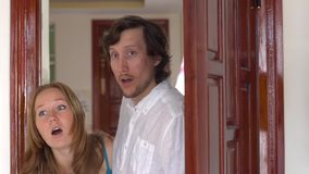 A man and a woman come into his new apartment, and they like it. New housing concept.  stock footage